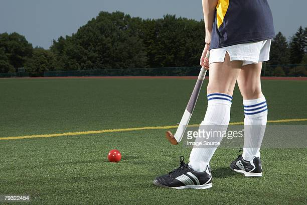 a hockey players legs - ice hockey uniform stock pictures, royalty-free photos & images