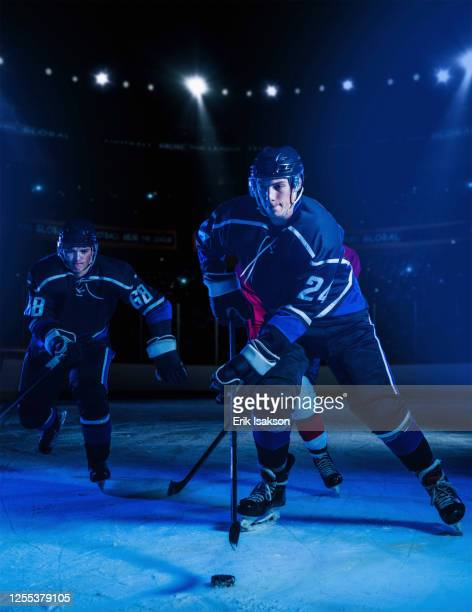 hockey players on ice - ice hockey uniform stock pictures, royalty-free photos & images