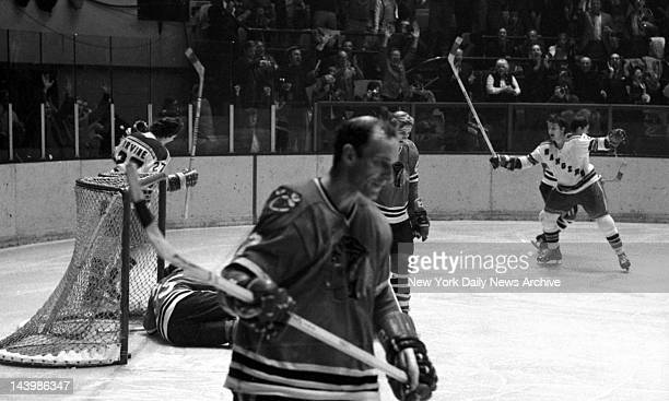 Hockey Playoffs Rangers vs Chicago Ranger Pete Stemkowski raises his stick in triumph after scoring the winning goal as Chicago goalie Tony Esposito...