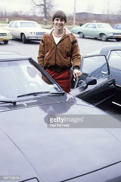 Portrait of Buffalo Sabres Rob McClanahan posing with his car in parking lot Buffalo NY CREDIT Paul Kennedy 079007156