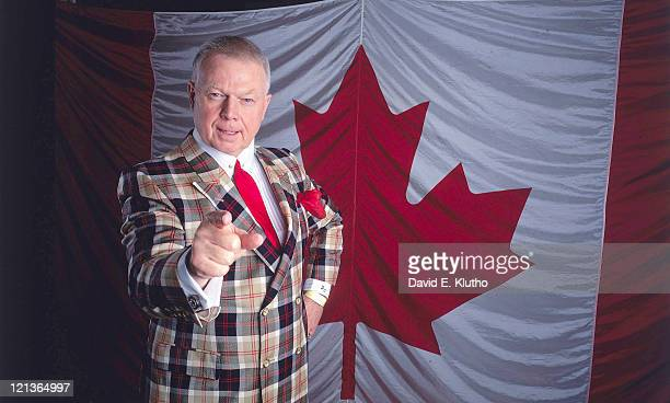 Portrait of Canadian TV hockey personality Don Cherry posing in front of Canadian flag during photo shoot Mississauga Canada 3/6/1993 CREDIT David E...