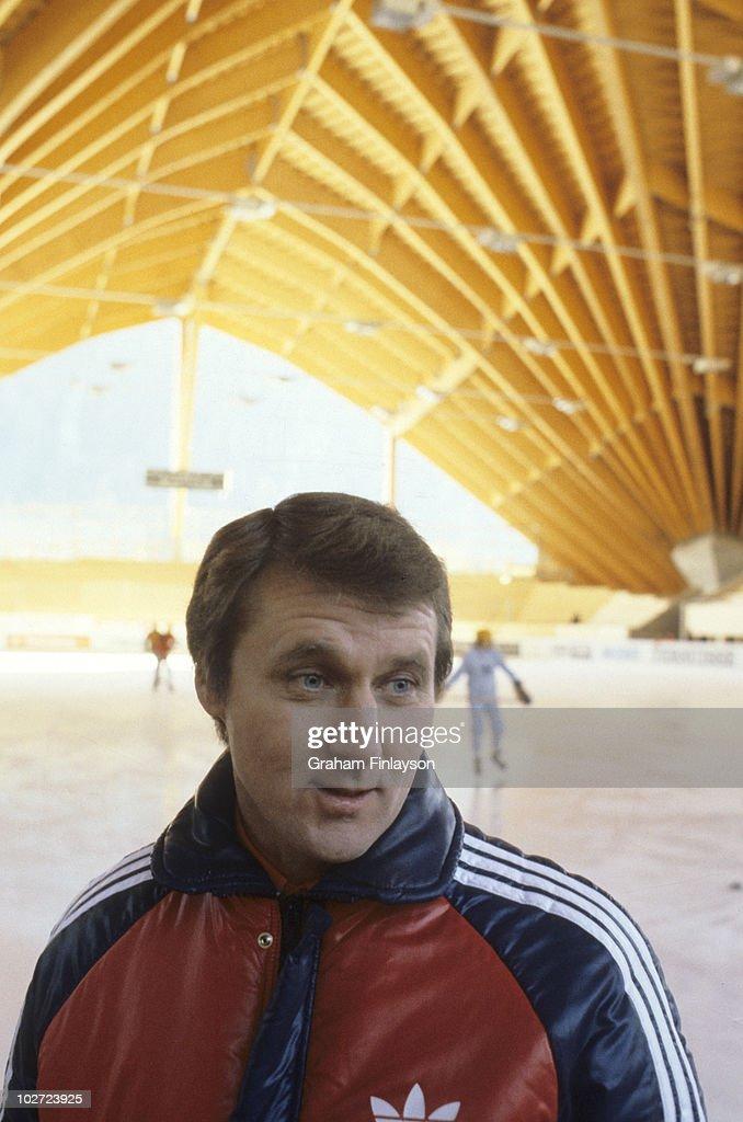 Portrait of former USA coach Herb Brooks posing inside arena. Davos, Switzerland