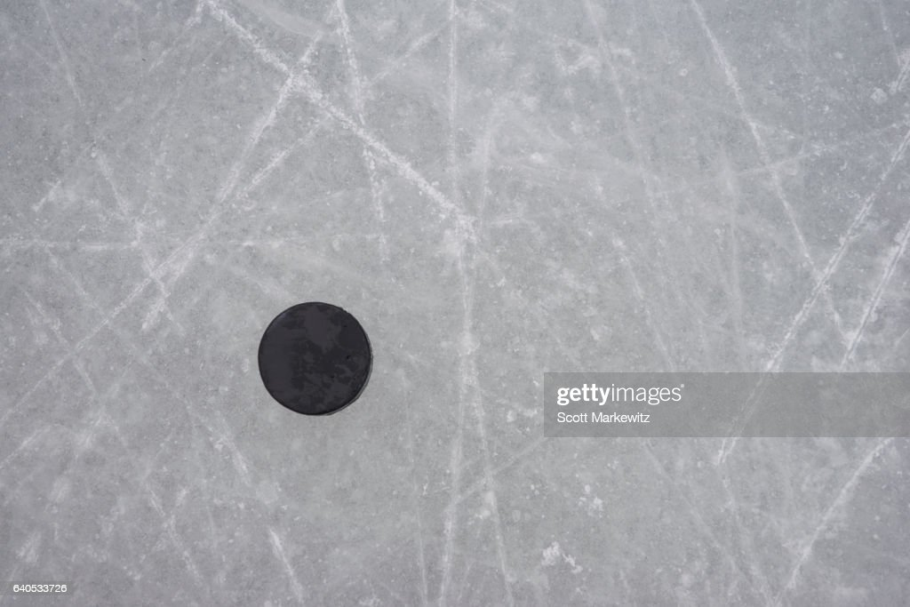 A hockey puck on an ice rink : Stock Photo