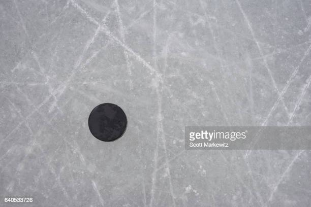 A hockey puck on an ice rink
