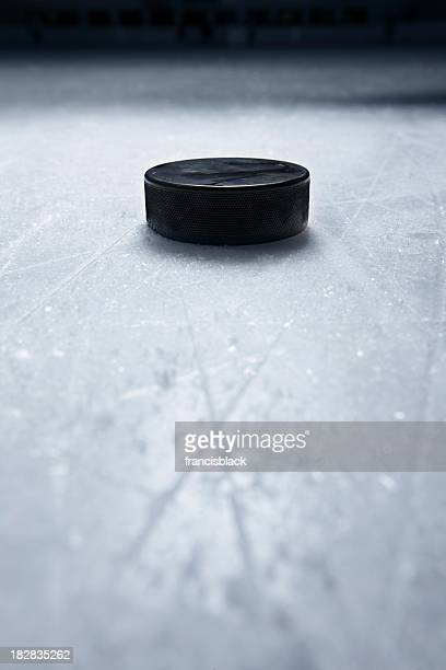 hockey puck on ice - hockey puck stock pictures, royalty-free photos & images