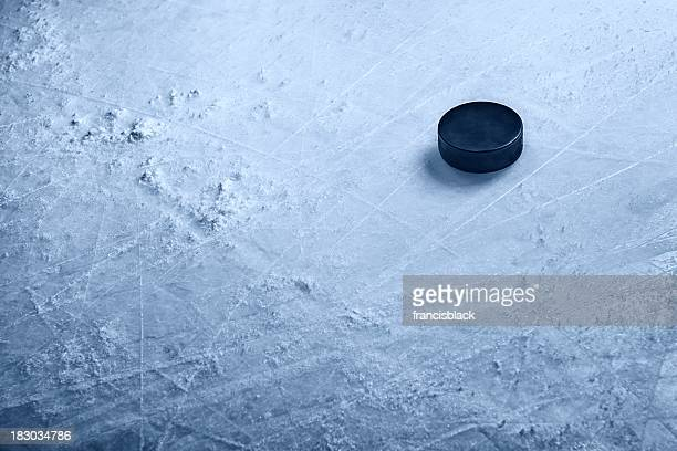 hockey puck on ice - hockey stock pictures, royalty-free photos & images