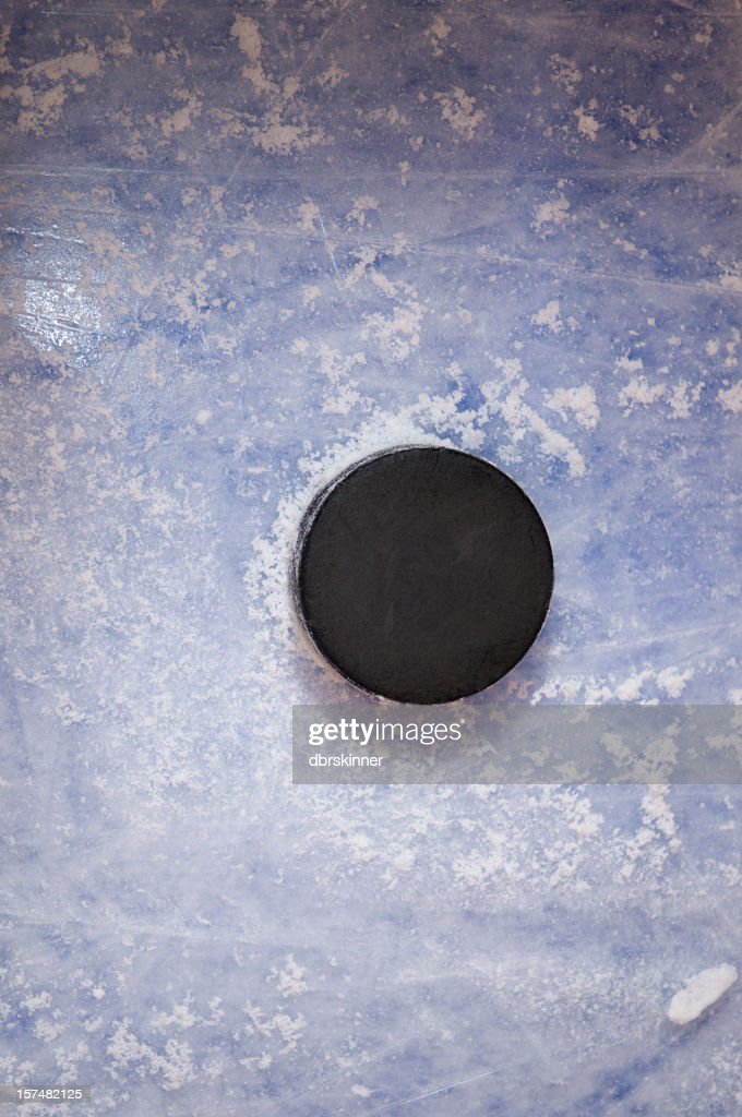 Hockey Puck on the blue line : Stock Photo