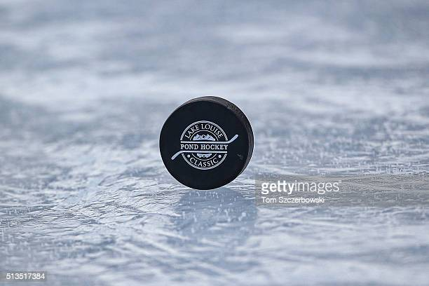 A hockey puck on the ice surface during the 7th Annual Lake Louise Pond Hockey Classic on the frozen surface of Lake Louise on February 27 2016 in...