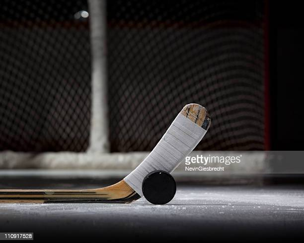 hockey puck, stick, and net (landscape) - hockey puck stock pictures, royalty-free photos & images