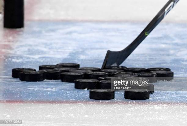 Hockey pucks are gathered in the crease during warmups before a game between the Tampa Bay Lightning and the Vegas Golden Knights at TMobile Arena on...
