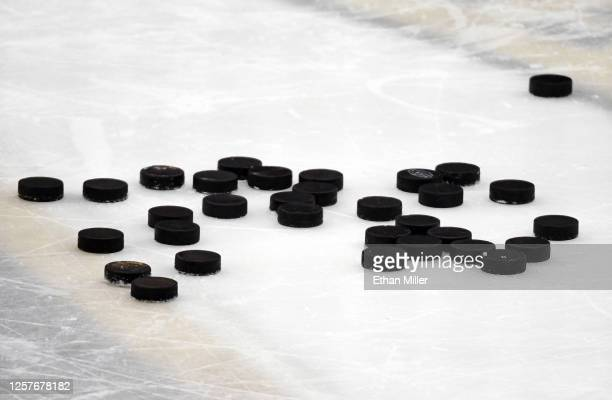 Hockey pucks are gathered on the ice during a training camp practice for the Vegas Golden Knights at City National Arena on July 22, 2020 in Las...