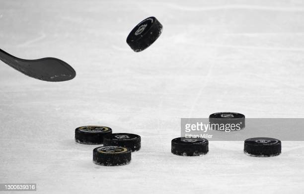 Hockey pucks are shown on the ice during warmups before a game between the Los Angeles Kings and the Vegas Golden Knights at T-Mobile Arena on...