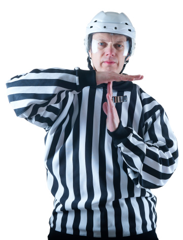Hockey referee demonstrate timeout gesture 474877987