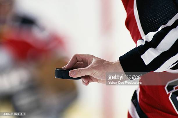 hockey referee poised to put puck into play, close-up - puck stock pictures, royalty-free photos & images