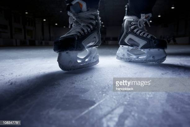hockey skates on ice - ice hockey stock pictures, royalty-free photos & images