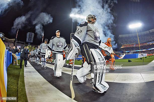 Stadium Series View of Los Angeles Kings goalies Jonathan Quick and Martin Jones leading team onto ice before game vs Anaheim Ducks at Dodger Stadium...