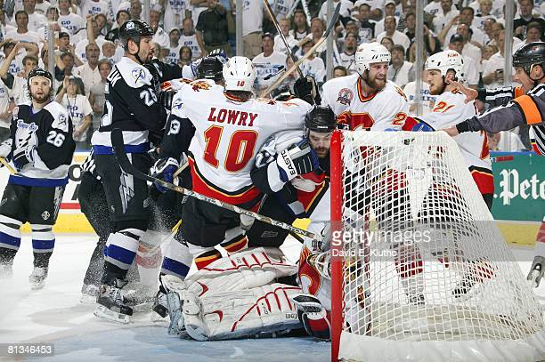 Hockey Stanley Cup finals Calgary Flames goalie Mikka Kiprusoff and Dave Lowry in action vs Tampa Bay Lightning's Dan Boyle Tampa FL 6/3/2004
