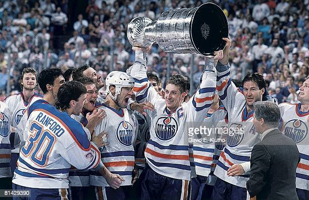 Hockey: Stanley Cup finals, Edmonton Oilers Bill Ranford, Esa Tikkanen, Mark Messier, Wayne Gretzky, and Kevin Lowe victorious with trophy after...