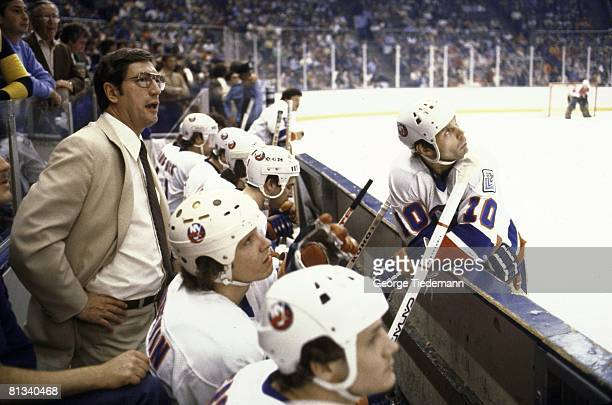 Hockey Stanley Cup finals New York Islanders coach Al Arbour on bench with team during game vs Philadelphia Flyers Uniondale NY 5/17/1980