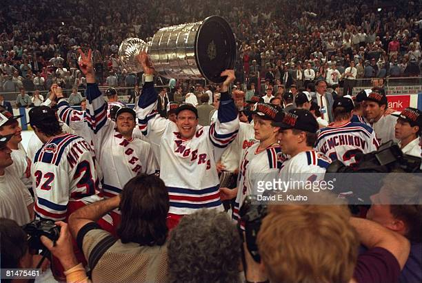 Hockey Stanley Cup finals New York Rangers Mark Messier victorious with trophy after winning game vs Vancouver Canucks New York NY 6/14/1994