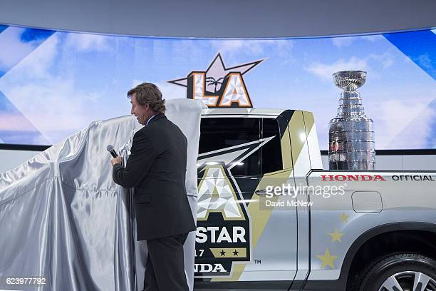 Hockey star Wayne Gretzky unveils a Honda Ridgeline pickup truck revealing the Stanley Cup trophy in its bed that will be given to the MVP player of...