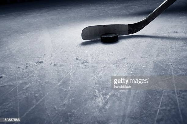 hockey stick and puck on ice - ice hockey stick stock pictures, royalty-free photos & images