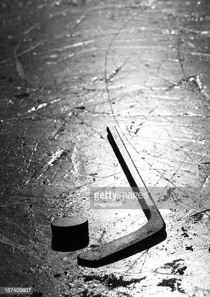 hockey stick and puck on pond ice rink outside - hockey stick stock pictures, royalty-free photos & images