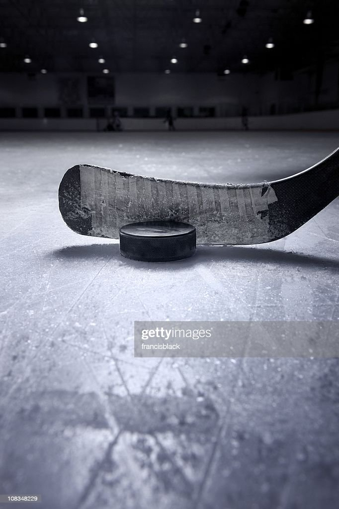 Hockey Stick and Puck : Stock Photo