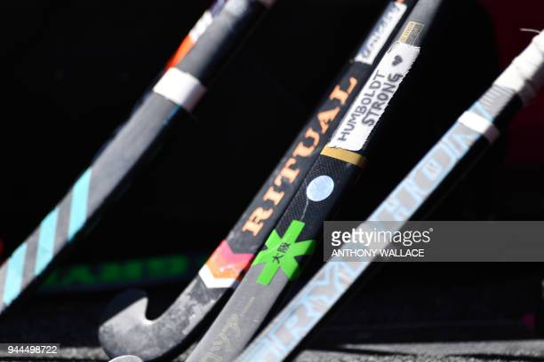 A hockey stick belonging to a Canadian teammate is seen with a handwritten label that says Humboldt Strong in tribute to the Humboldt Broncos junior...