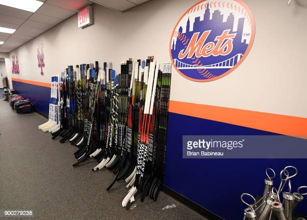 Hockey sticks are lined up in the hallway prior to the 2018 Bridgestone NHL Winter Classic between the New York Rangers and the Buffalo Sabres at...