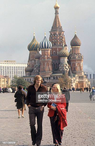 Summit Series Portrait of Team Canada goalie Ken Dryden casual walking with wife Lynda in Red Square Moscow Soviet Union 9/23/1972 CREDIT Melchior...
