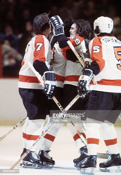 Super Series '76 Philadelphia Flyers Reggie Leach victorious with Rick MacLeish Bill Barber and Larry Goodenough after scoring goal vs Moscow Red...