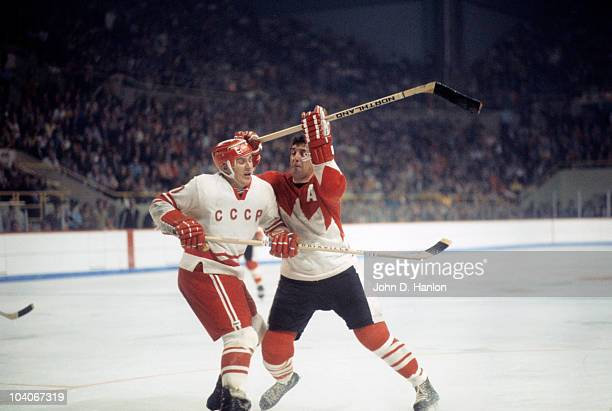 The Summit Series Canada Phil Esposito in action vs Gennady Tsygankov of the Soviet Union at the Winnipeg Arena Game 3 Winnipeg Canada 9/6/1972...