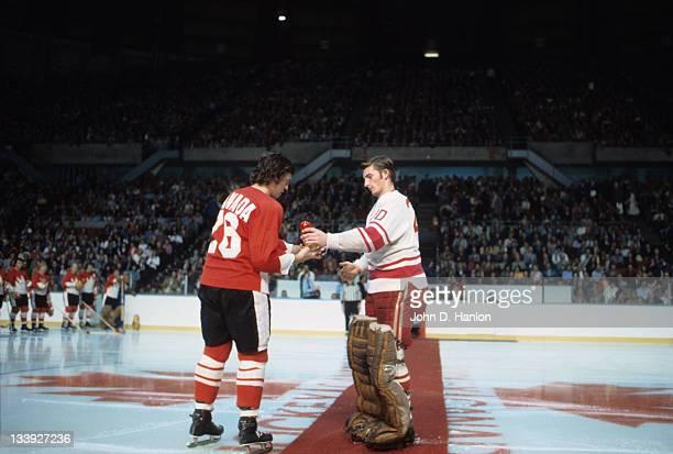 The Summit Series Soviet Union goalie Vladislav Tretiak and Canada Bobby Clarke on ice before game at Winnipeg Arena Game 3 Winnipeg Canada 9/6/1972...