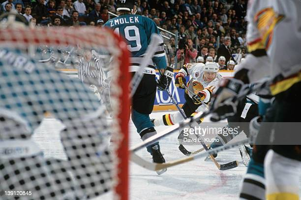 Vancouver Canucks Pavel Bure in action taking shot vs San Jose Sharks at Pacific Coliseum Vancouver Canada CREDIT David E Klutho