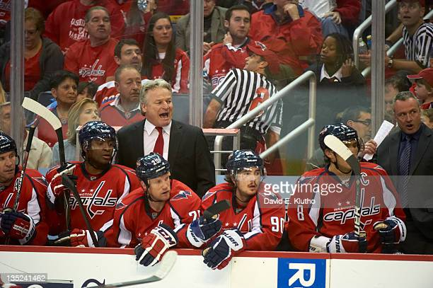 Washington Capitals Alex Ovechkin on bench with head coach Dale Hunter in background during game vs Ottawa Senators at Verizon Center Washington DC...