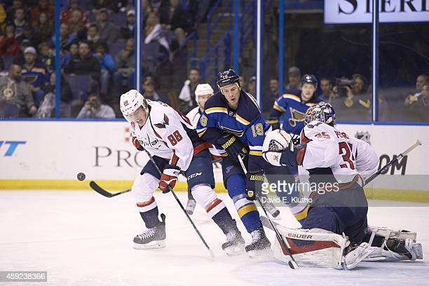 Washington Capitals goalie Justin Peters and Nate Schmidt in action vs St Louis Blues Jay Bouwmeester at Scottrade Center St Louis MO CREDIT David E...