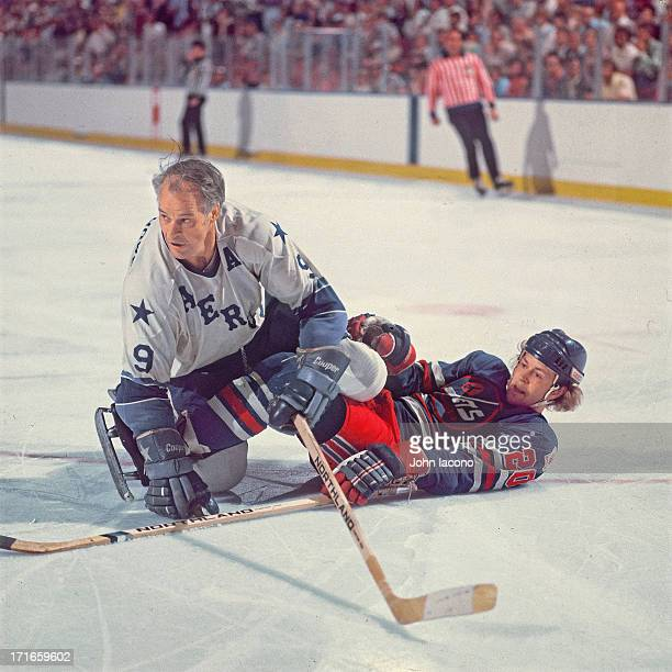 WHA Finals Houston Aeros Gordie Howe in action check vs Winnipeg Jets Willy Lindstrom at The Summit Game 1 Houston TX CREDIT John Iacono
