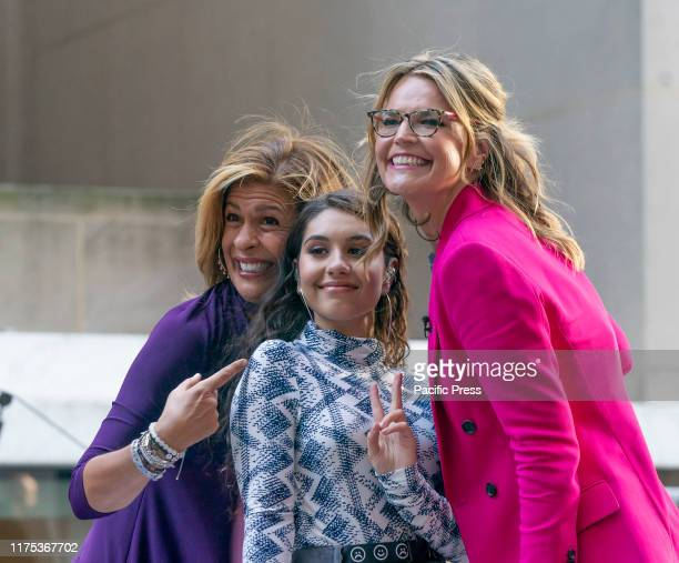 Hoda Kotb Alessia Cara Savannah Guthrie pose on stage during NBC Today Show concert in honor of International Day of the Girl at Rockfeller Plaza
