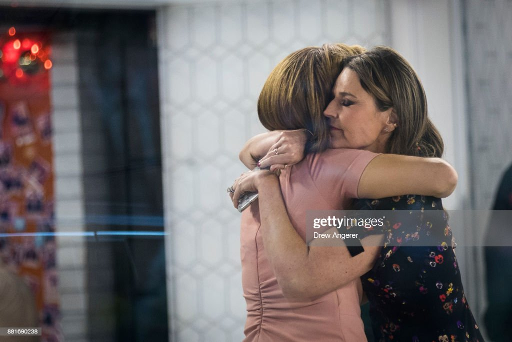 Hoda Kotb and Savannah Guthrie embrace at the end of the show on the set of NBC's Today Show, November 29, 2017 in New York City. It was announced on Wednesday morning that long time Today Show host Matt Lauer had been fired for alleged sexual misconduct.
