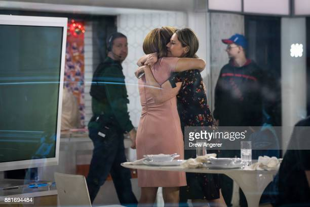 Hoda Kotb and Savannah Guthrie embrace at the end of the show on the set of NBC's Today Show November 29 2017 in New York City It was announced on...