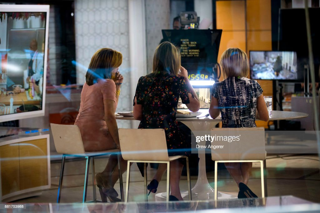 Hoda Kotb, Savannah Guthrie and Dylan Dreyer sit at a table during a break on the set of NBC's Today Show, November 29, 2017 in New York City. It was announced on Wednesday morning that long time Today Show host Matt Lauer had been fired for sexual misconduct.