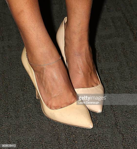 Hoda Kotb shoe detail signs copies of 'Where We Belong Journeys That Show Us The Way' at Barnes Noble 86th Lexington on January 5 2016 in New York...