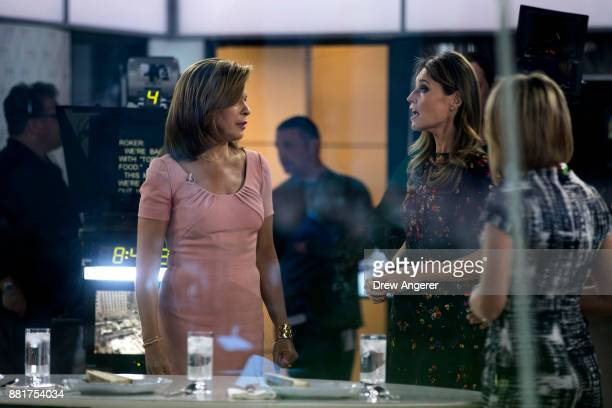Hoda Kotb talks with Savannah Guthrie during a break on the set of NBC's Today Show November 29 2017 in New York City It was announced on Wednesday...