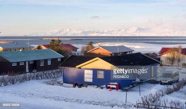 Hoefn i Hornafirdi living quarter with view towards the mountains of the Vatnajoekull NP Europe northern Europe Iceland February