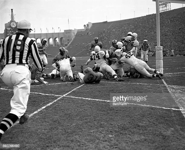 Hoerner of the Los Angeles Rams plunges three yards for a Rams touchdown during the second quarter of their game against the Cleveland Browns for the...
