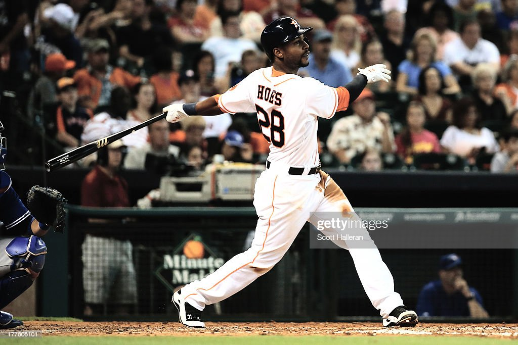 L.J. Hoes #28 of the Houston Astros drives in a run with a double in the fourth inning against the Toronto Blue Jays at Minute Maid Park on August 24, 2013 in Houston, Texas.