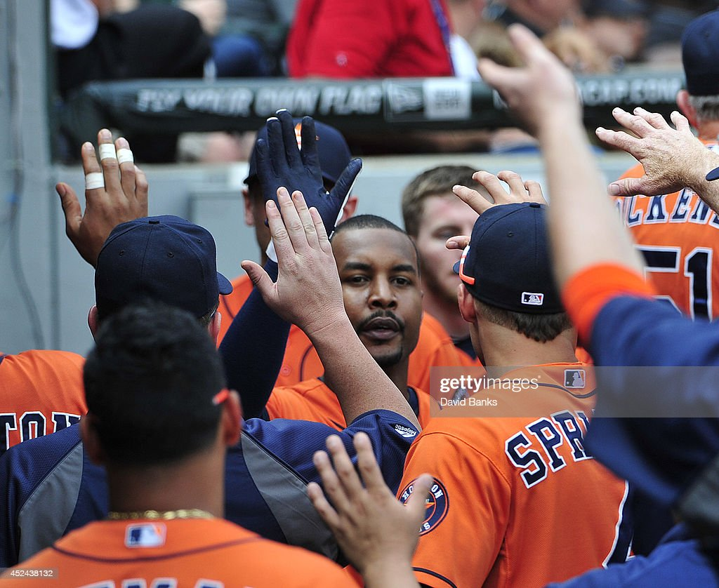 L.J. Hoes #1 of the Houston Astros is greeted after scoring against the Chicago White Sox during the seventh inning on July 20, 2014 at U.S. Cellular Field in Chicago, Illinois.