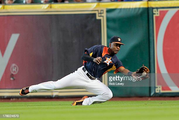 Hoes of the Houston Astros makes a diving catch on a line drive hit by Adrian Beltre of the Texas Rangers in the second inning at Minute Maid Park on...