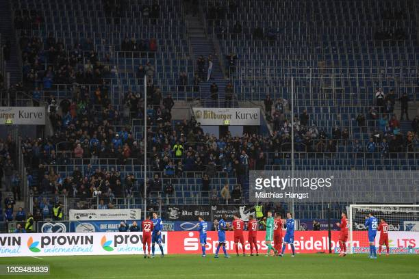 Hoffenheim fans leave the stadium as players protest on the pitch against demonstrations by FC Bayern Muenchen fans during the Bundesliga match...